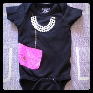 Sara Kety hot pink Chanel bag onesie in black